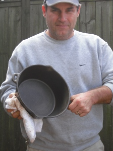 Kevin and one of his many cast-iron cookware pieces.