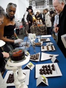 Master chocolatier Joseph Schmidt, right, samples the wares at the Chocolate Salon.